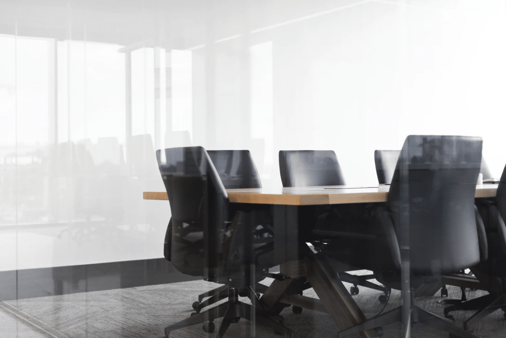 Rolling chairs around conference table