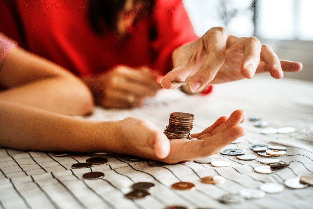 Woman dropping quarter onto a stack